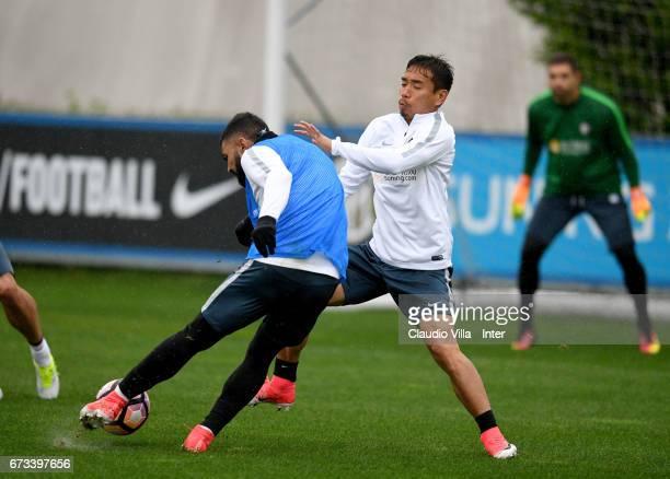 Gabriel Barbosa Almeida and Yuto Nagatomo of FC Internazionale compete for the ball during FC Internazionale training session at Suning Training...