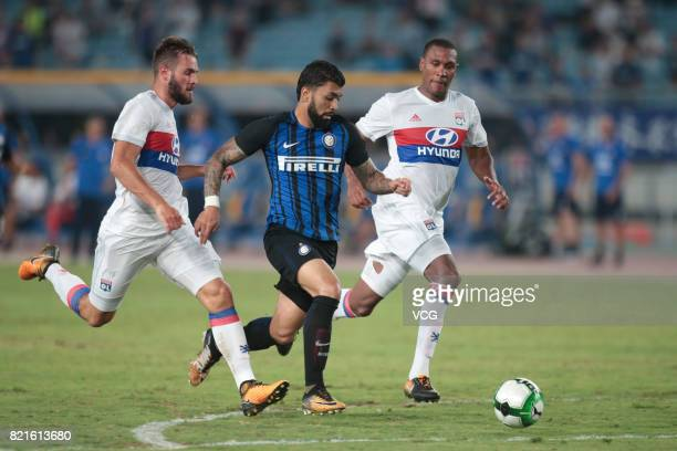 Gabriel Barbosa Almeida of FC Internazionale Marcelo Antonio Guedes Filho and Lucas Tousart of Lyon compete for the ball during the 2017...