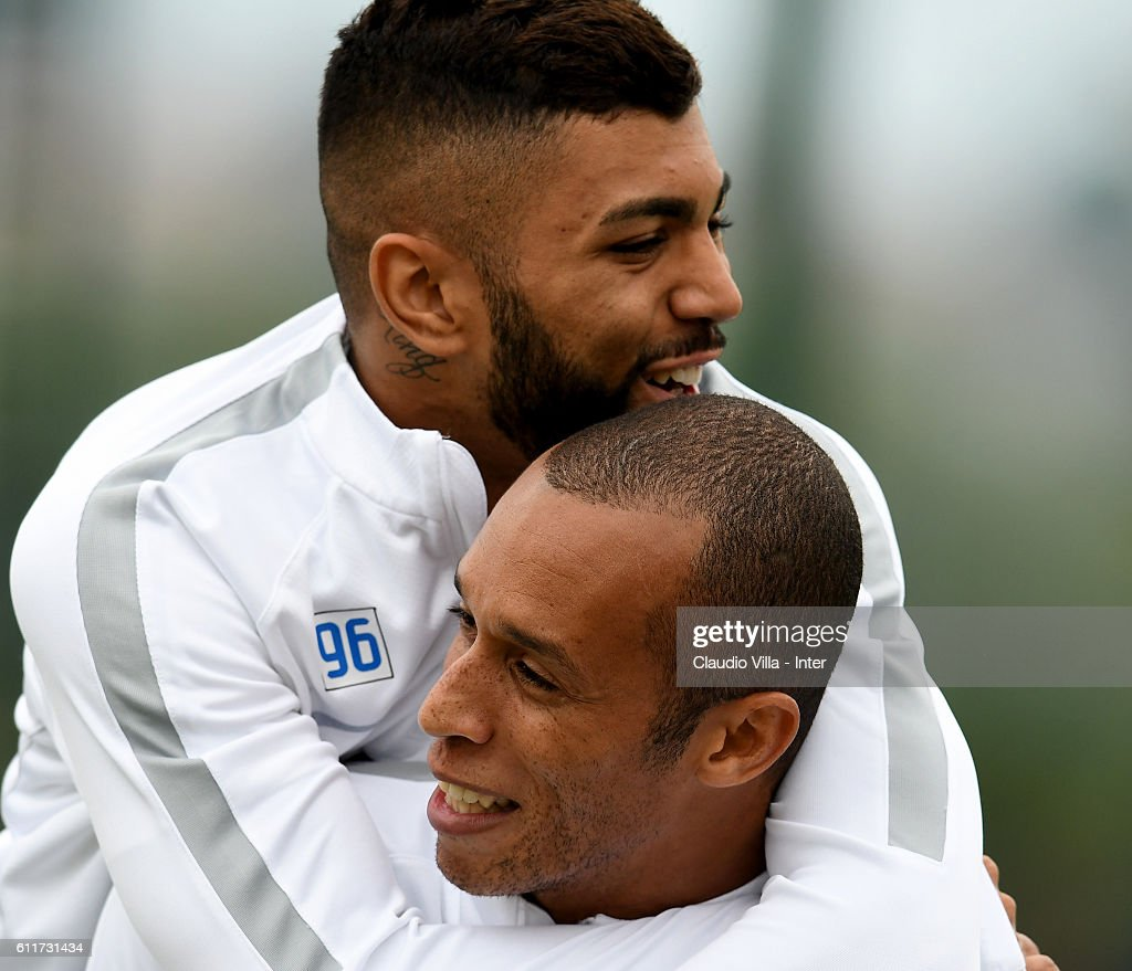 Gabriel Barbosa (L) and Miranda during the FC Internazionale training session at the club's training ground at Appiano Gentile on October 01, 2016 in Como, Italy.