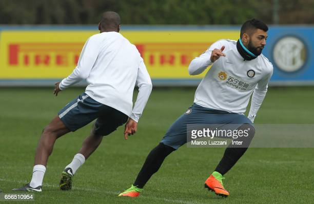 Gabriel Barbosa Gabigol and Geoffrey Kondogbia of FC Internazionale Milano run during the FC Internazionale training session at the club's training...