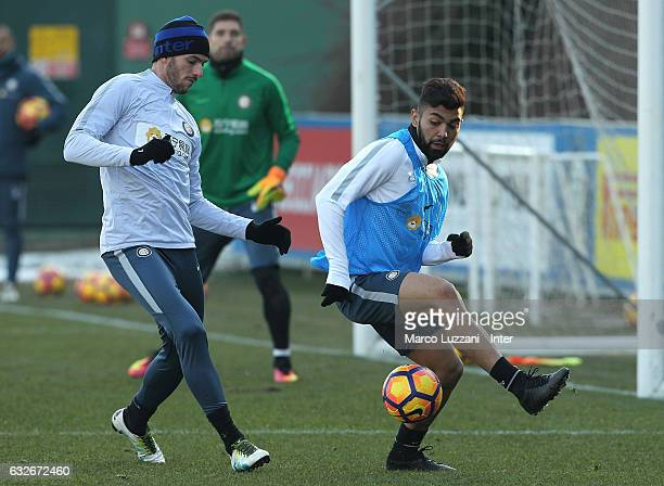 Gabriel Barbosa Gabigol competes with Davide Santon during the FC Internazionale training session at the club's training ground Suning Training...