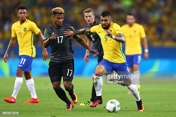 Gabriel Barbosa of Brazil and Serge Gnabry of Germany in action during the Men's Football Final between Brazil and Germany at the Maracana Stadium on...