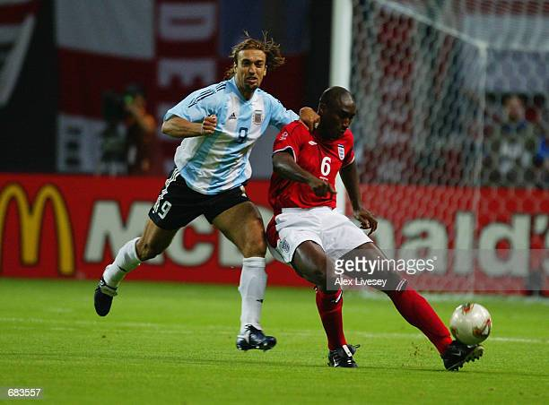 Gabriel Batistuta of Argentina challenges Sol Campbell of England during the England v Argentina Group F World Cup Group Stage match played at the...