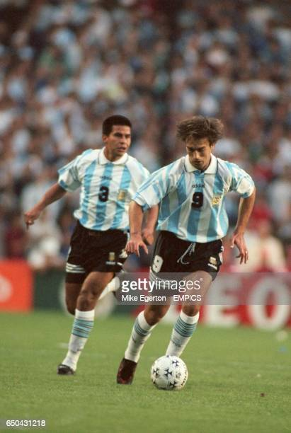 Gabriel Batistuta of Argentina moves forward with teammate Roberto Ayala in suport