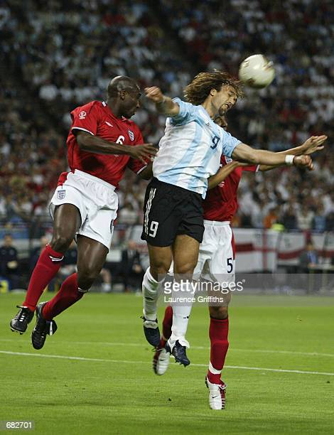 Gabriel Batistuta of Argentina wins the ball in the air against Sol Campbell and Rio Ferdinand of England during the FIFA World Cup Finals 2002 Group...