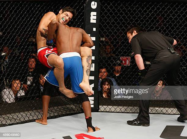 Gabriel Benitez attempts to submit Humberto Brown in their featherweight bout during the UFC 180 event at Arena Ciudad de Mexico on November 15 2014...