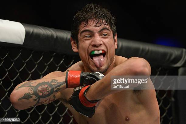 Gabriel Benitez celebrates after defeating Humberto Brown in their featherweight bout during the UFC 180 event at Arena Ciudad de Mexico on November...