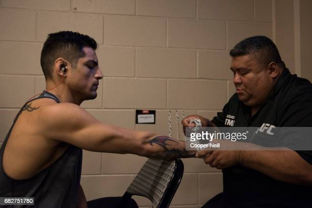 Gabriel Benitez has his hands wrapped before fighting Enrique Barzola during UFC 211 at the American Airlines Center on May 13 2017 in Dallas Texas