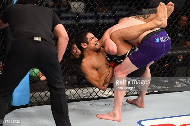 Gabriel Benitez of Mexico attempts to submit Clay Collard of the United States in their featherweight bout during the UFC 188 event at the Arena...