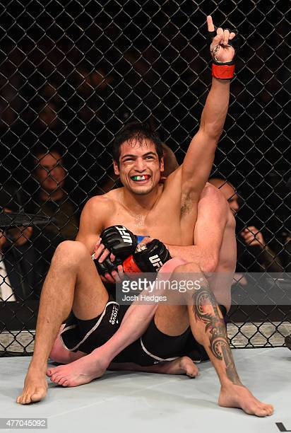 Gabriel Benitez of Mexico celebrates at the end of the final round against Clay Collard of the United States in their featherweight bout during the...