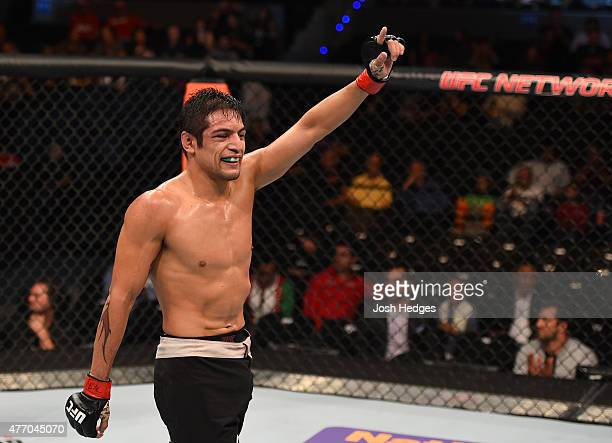 Gabriel Benitez of Mexico celebrates his victory over Clay Collard of the United States in their featherweight bout during the UFC 188 event at the...