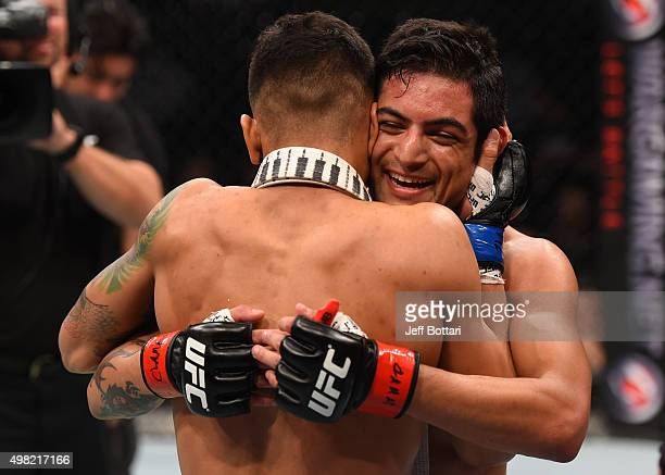 Gabriel Benitez of Mexico congratulates opponent Andre Fili of the United States after Fili's knockout victory over Benitez in their featherweight...