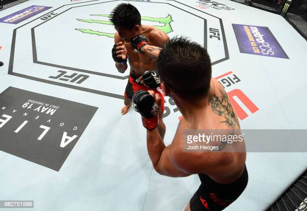 Gabriel Benitez punches Enrique Barzola in their featherweight fight during the UFC 211 event at the American Airlines Center on May 13 2017 in...