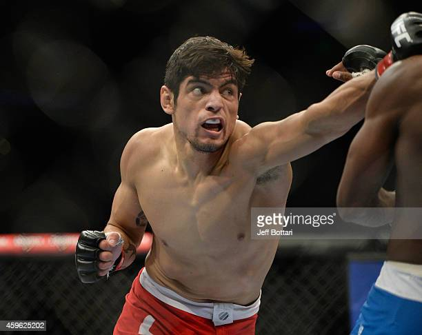 Gabriel Benitez punches Humberto Brown in their featherweight bout during the UFC 180 event at Arena Ciudad de Mexico on November 15 2014 in Mexico...