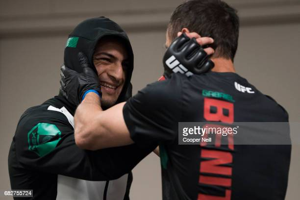 Gabriel Benitez talks with his coach before fighting Enrique Barzola during UFC 211 at the American Airlines Center on May 13 2017 in Dallas Texas