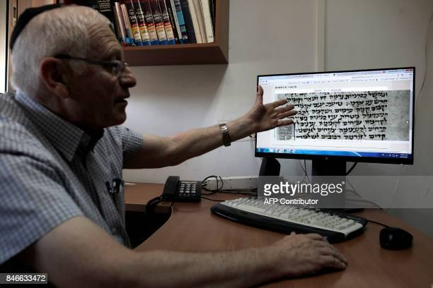 Gabriel Birnbaum senior researcher at Historical Dictionary Project at Israel's Academy of the Hebrew Language in Jerusalem shows an old Hebrew text...