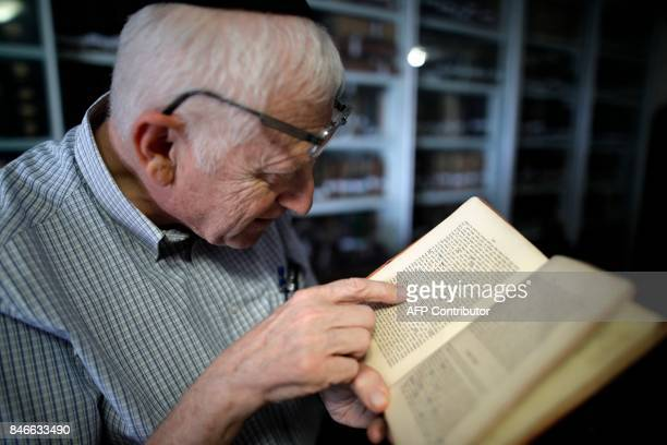 Gabriel Birnbaum senior researcher at Historical Dictionary Project at Israel's Academy of the Hebrew Language in Jerusalem inspects remarks in an...