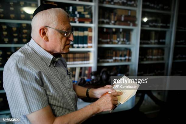 Gabriel Birnbaum senior researcher at Historical Dictionary Project at Israel's Academy of the Hebrew Language in Jerusalem shows old notes written...