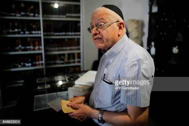Gabriel Birnbaum senior researcher at Historical Dictionary Project at Israel's Academy of the Hebrew Language in Jerusalem holds old notes written...