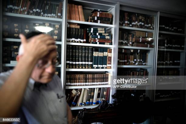 Gabriel Birnbaum senior researcher at Historical Dictionary Project at Israel's Academy of the Hebrew Language in Jerusalem stand of a room with old...