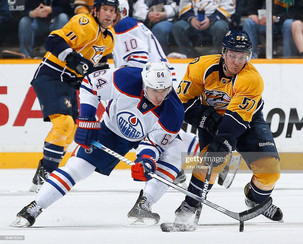 Gabriel Bourque #57 of the Nashville Predators battle for the puck against <a gi-track='captionPersonalityLinkClicked' href=/galleries/search?phrase=Nail+Yakupov&family=editorial&specificpeople=7419136 ng-click='$event.stopPropagation()'>Nail Yakupov</a> #64 of the Edmonton Oilers during an NHL game at the Bridgestone Arena on March 25, 2013 in Nashville, Tennessee.