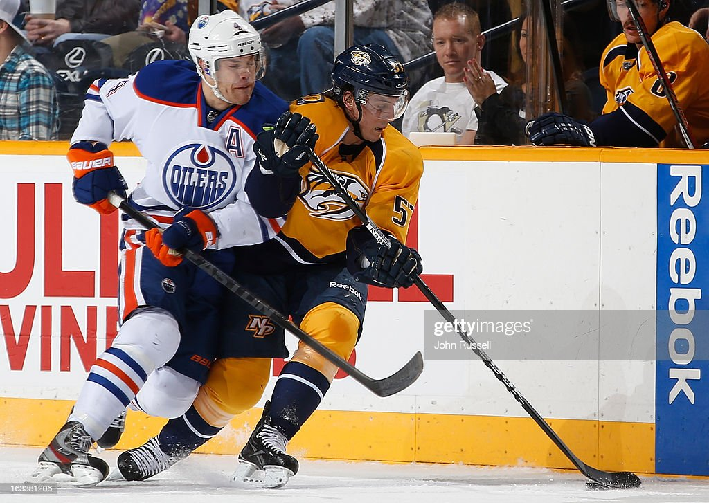 Gabriel Bourque #57 of the Nashville Predators battles against <a gi-track='captionPersonalityLinkClicked' href=/galleries/search?phrase=Taylor+Hall&family=editorial&specificpeople=2808377 ng-click='$event.stopPropagation()'>Taylor Hall</a> #4 of the Edmonton Oilers during an NHL game at the Bridgestone Arena on March 8, 2013 in Nashville, Tennessee.