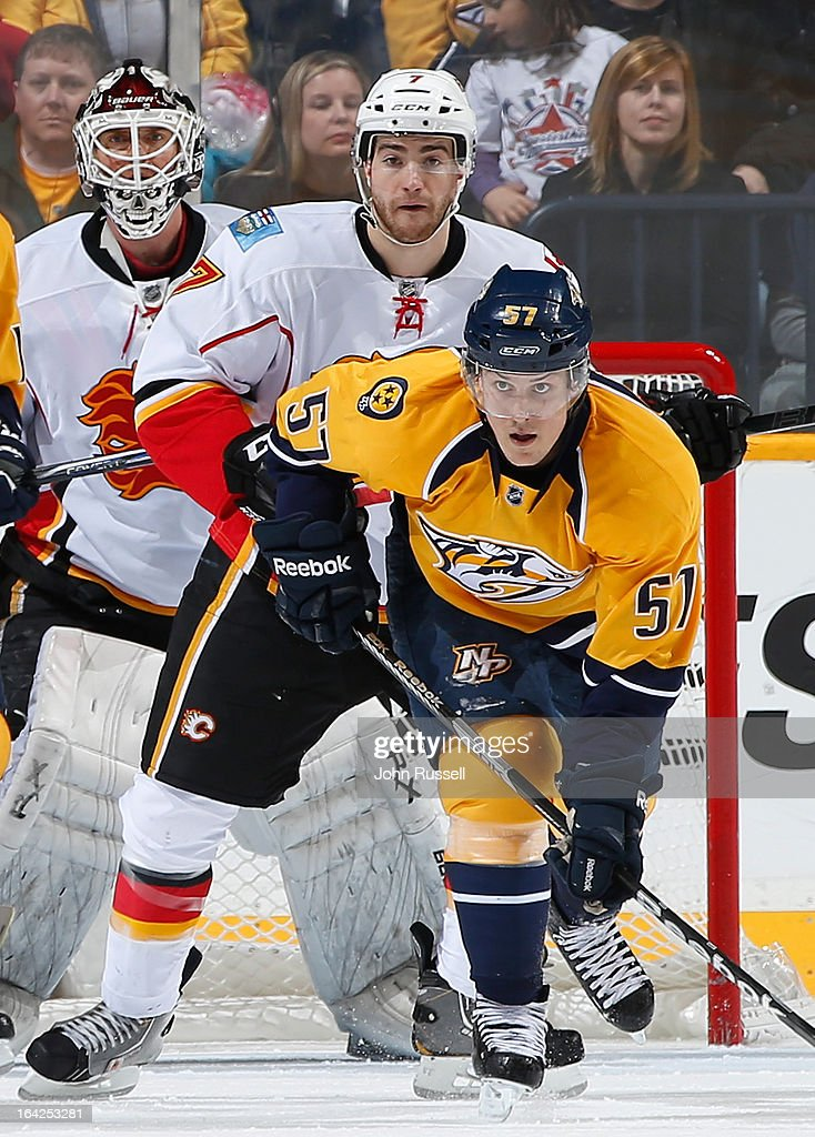 Gabriel Bourque #57 of the Nashville Predators battles against <a gi-track='captionPersonalityLinkClicked' href=/galleries/search?phrase=TJ+Brodie&family=editorial&specificpeople=7220398 ng-click='$event.stopPropagation()'>TJ Brodie</a> #7 of the Calgary Flames during an NHL game at the Bridgestone Arena on March 21, 2013 in Nashville, Tennessee.
