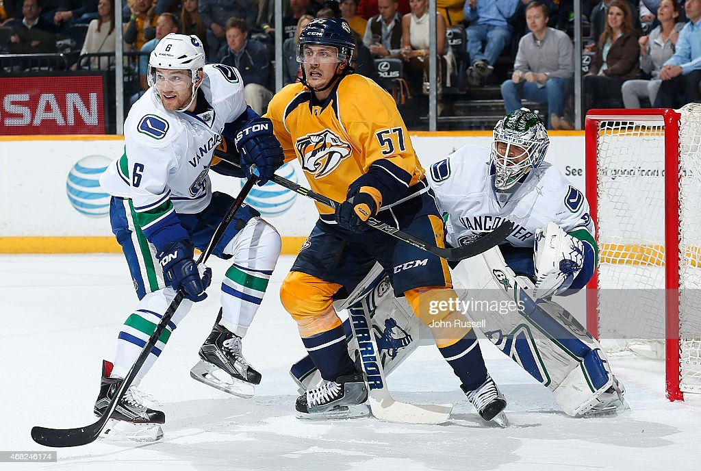 Gabriel Bourque #57 of the Nashville Predators battles between Yannick Weber #6 and Eddie Lack #31 of the Vancouver Canucks during an NHL game at Bridgestone Arena on March 31, 2015 in Nashville, Tennessee.
