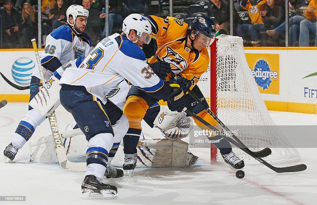 Gabriel Bourque #57 of the Nashville Predators battles for the puck against Jordan Leopold #33 of the St. Louis Blues at Bridgestone Arena on October 26, 2013 in Nashville, Tennessee.