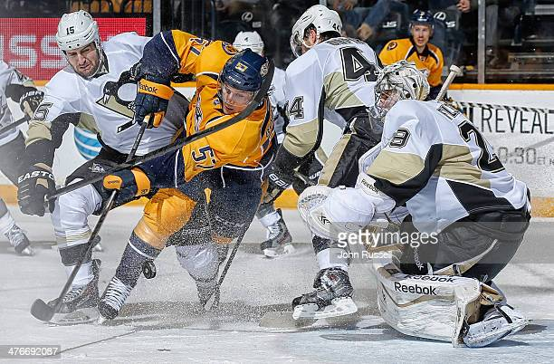 Gabriel Bourque of the Nashville Predators battles in front of the net against MarcAndre Fleury and Tanner Glass of the Pittsburgh Penguins at...