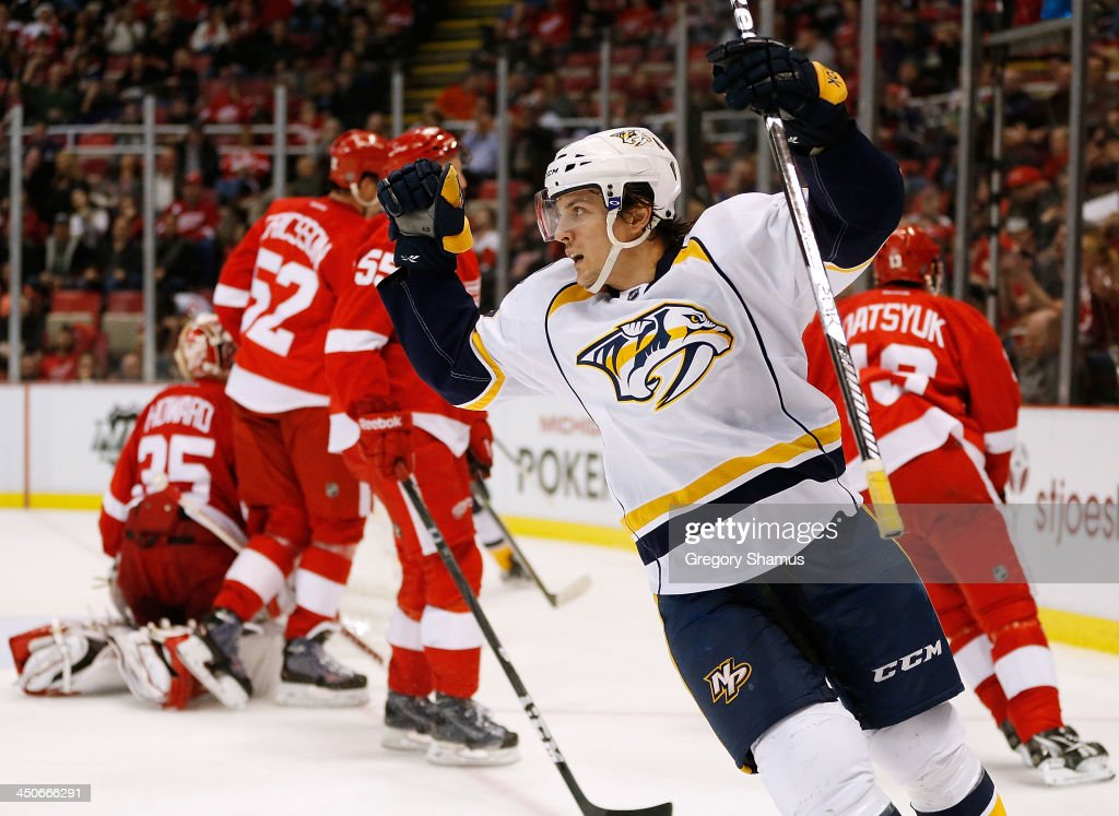 Gabriel Bourque #57 of the Nashville Predators celebrates a third-period goal by teammate David Legwand #11 while playing the Detroit Red Wings at Joe Louis Arena on November 19, 2013 in Detroit, Michigan. Nashville won the game 2-0.