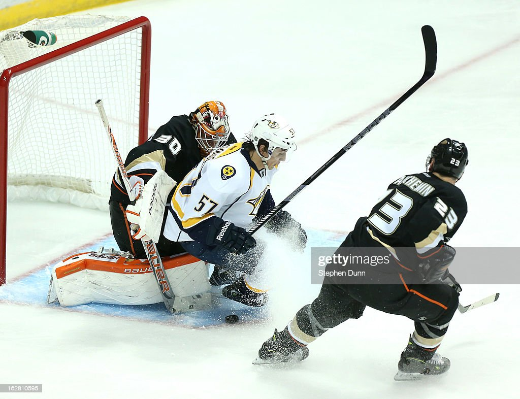 Gabriel Bourque #57 of the Nashville Predators crashes into goalie Viktor Fasth #30 of the Anaheim Ducks at Honda Center on February 27, 2013 in Anaheim, California. The Ducks won 5-1.