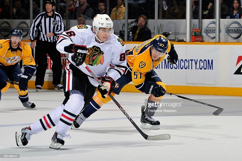 Gabriel Bourque #57 of the Nashville Predators pursues Patrick Kane #88 of the Chicago Blackhawks at the Bridgestone Arena on February 10, 2013 in Nashville, Tennessee.
