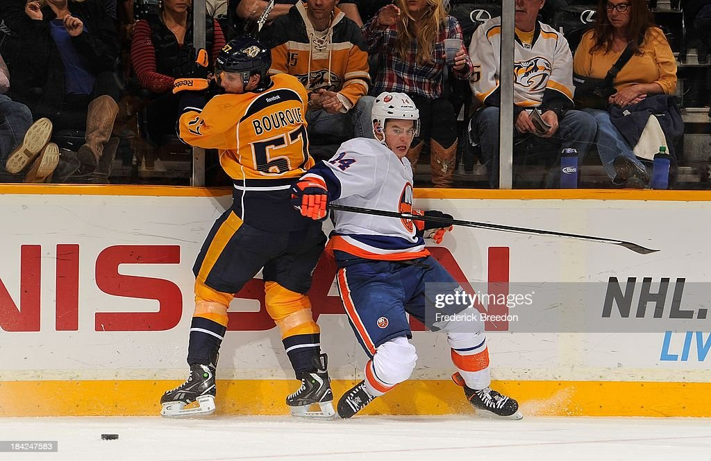 <a gi-track='captionPersonalityLinkClicked' href=/galleries/search?phrase=Gabriel+Bourque&family=editorial&specificpeople=5627917 ng-click='$event.stopPropagation()'>Gabriel Bourque</a> #57 of the Nashville Predators skates against Thomas Hickey #14 of the New York Islanders at Bridgestone Arena on October 12, 2013 in Nashville, Tennessee.
