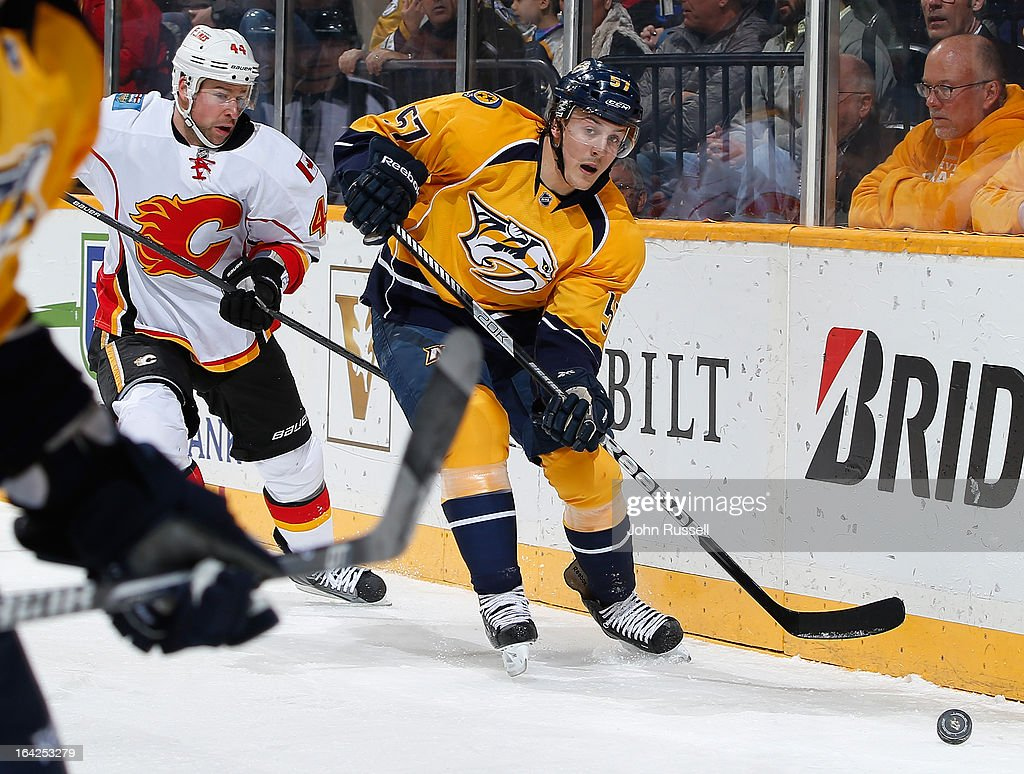 Gabriel Bourque #57 of the Nashville Predators skates away from Chris Butler #44 of the Calgary Flames during an NHL game at the Bridgestone Arena on March 21, 2013 in Nashville, Tennessee.