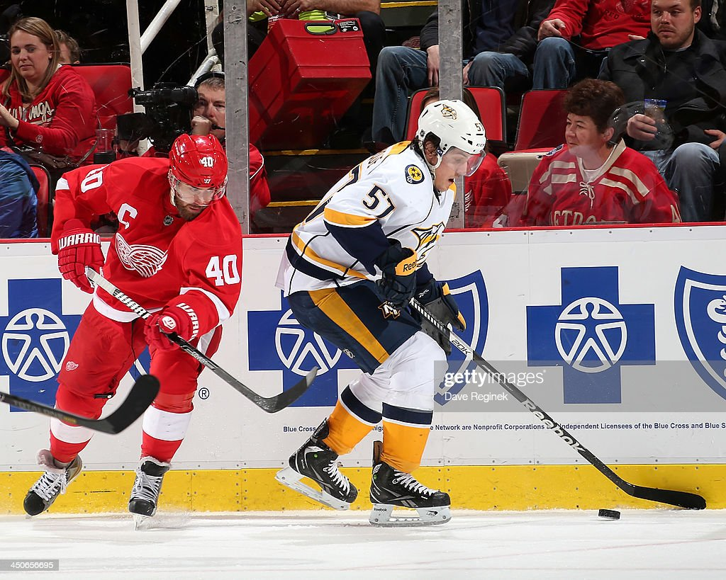 Gabriel Bourque #57 of the Nashville Predators skates with the puck as Henrik Zetterberg #40 of the Detroit Red Wings pressures him during an NHL game at Joe Louis Arena on November 19, 2013 in Detroit, Michigan. Nashville defeated Detroit 2-0