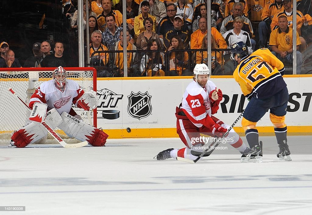 Gabriel Bourque #57 of the Nashville Predators takes a shot past <a gi-track='captionPersonalityLinkClicked' href=/galleries/search?phrase=Brad+Stuart+-+Ice+Hockey+Player&family=editorial&specificpeople=213995 ng-click='$event.stopPropagation()'>Brad Stuart</a> #23 of the Detroit Red Wings on goalie <a gi-track='captionPersonalityLinkClicked' href=/galleries/search?phrase=Jimmy+Howard&family=editorial&specificpeople=2118637 ng-click='$event.stopPropagation()'>Jimmy Howard</a> #35 in Game Five of the Western Conference Quarterfinals during the 2012 NHL Stanley Cup Playoffs at the Bridgestone Arena on April 20, 2012 in Nashville, Tennessee.