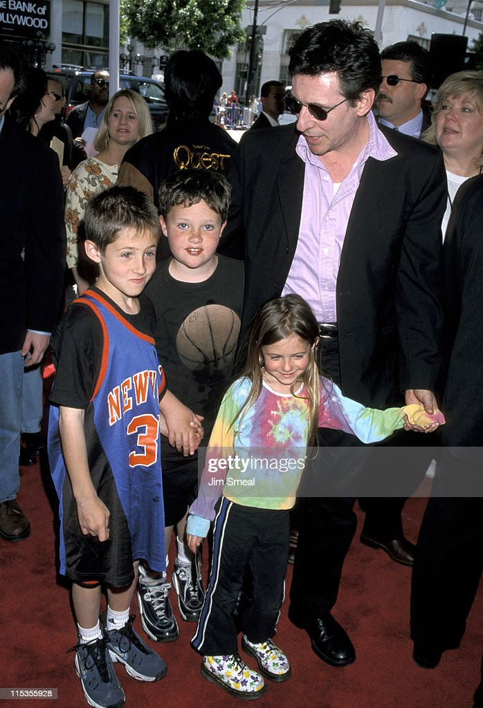 <a gi-track='captionPersonalityLinkClicked' href=/galleries/search?phrase=Gabriel+Byrne&family=editorial&specificpeople=216390 ng-click='$event.stopPropagation()'>Gabriel Byrne</a> (right) and children during 'Quest for Camelot' Premiere at Mann Chinese Theatre in Hollywood, California, United States.