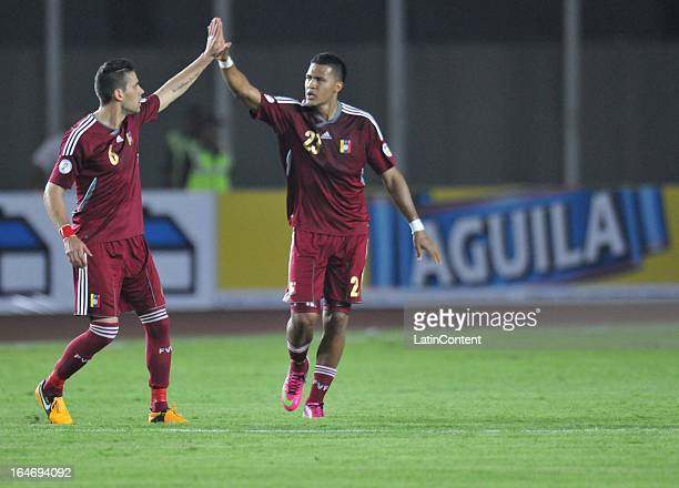 Gabriel Cichero and Jose Rondon of Venezuela celebrates a goal during a match between Venezuela and Colombia as part of the 12th round of the South...