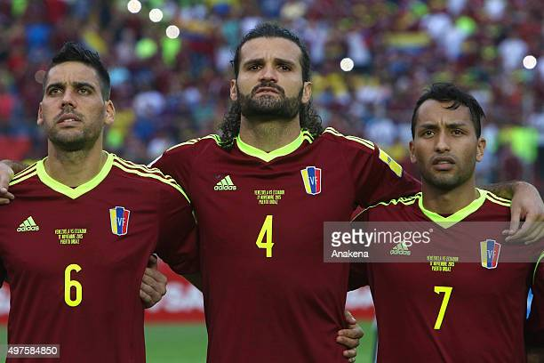 Gabriel Cichero Oswaldo Vizcarrondo and Jeffren Suarez of Venezuela sing during the anthem ceremony prior a match between Venezuela and Ecuador as...