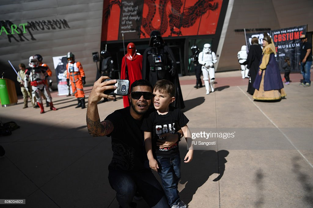 Gabriel Diaz, and his nephew Roman Diaz, 3, take a selfie outside the Denver Art Museum, May 04, 2016. The museum held a May the 4th Be With You event to kick off ticket sales for the upcoming exhibition, Star Wars and the Power of Costume, opening at the DAM in November.