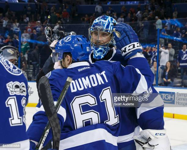 Gabriel Dumont and goalie Ben Bishop of the Tampa Bay Lightning celebrate the win against the Edmonton Oilers at Amalie Arena on February 21 2017 in...