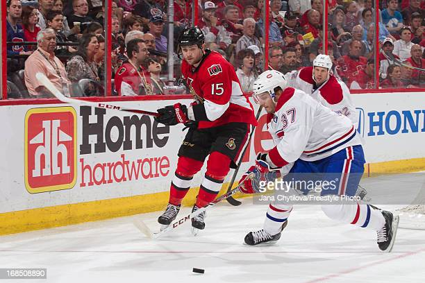 Gabriel Dumont of the Montreal Canadiens beats Zack Smith of the Ottawa Senators to the loose puck in Game Four of the Eastern Conference...