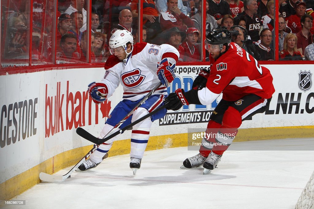 Gabriel Dumont #37 of the Montreal Canadiens controls the puck against <a gi-track='captionPersonalityLinkClicked' href=/galleries/search?phrase=Jared+Cowen&family=editorial&specificpeople=4594191 ng-click='$event.stopPropagation()'>Jared Cowen</a> #2 of the Ottawa Senators in Game Four of the Eastern Conference Quarterfinals during the 2013 NHL Stanley Cup Playoffs at Scotiabank Place on May 7, 2013 in Ottawa, Ontario, Canada.