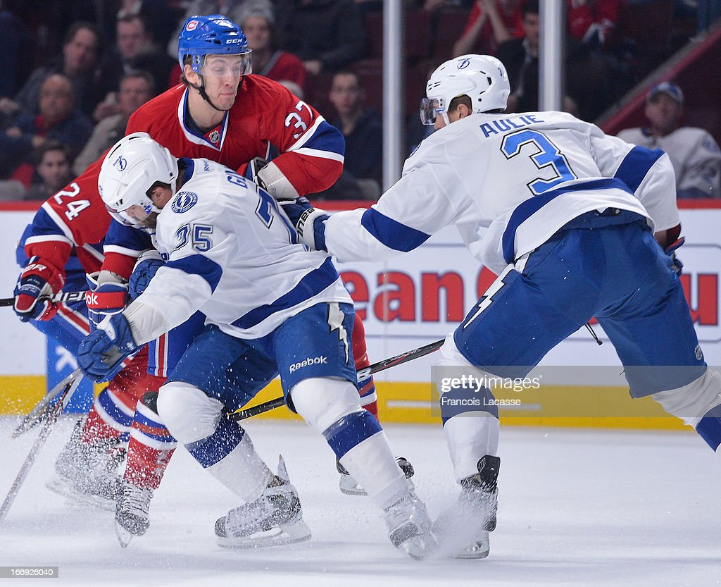 Gabriel Dumont #37 of the Montreal Canadiens is checked by <a gi-track='captionPersonalityLinkClicked' href=/galleries/search?phrase=Radko+Gudas&family=editorial&specificpeople=5648763 ng-click='$event.stopPropagation()'>Radko Gudas</a> #75 of the Tampa Bay Lightning during an NHL game on April 18, 2013 at the Bell Centre in Montreal, Quebec, Canada.