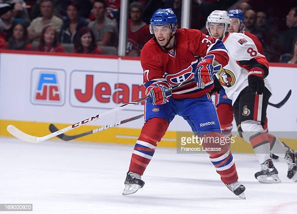 Gabriel Dumont of the Montreal Canadiens passes the puck against the Ottawa Senators in Game Five of the Eastern Conference Quarterfinals during the...