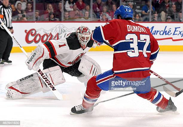 Gabriel Dumont of the Montreal Canadiens shoots on Keith Kinkaid of the New Jersey Devils in the NHL game at the Bell Centre on February 7 2015 in...
