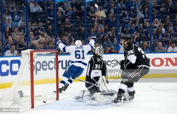 Gabriel Dumont of the Tampa Bay Lightning celebrates his goal against goalie Peter Budaj and Paul LaDue of the Los Angeles Kings during the second...