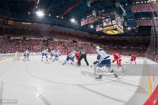 Gabriel Dumont of the Tampa Bay Lightning faces off against Dylan Larkin of the Detroit Red Wings during an NHL game at Joe Louis Arena on March 24...