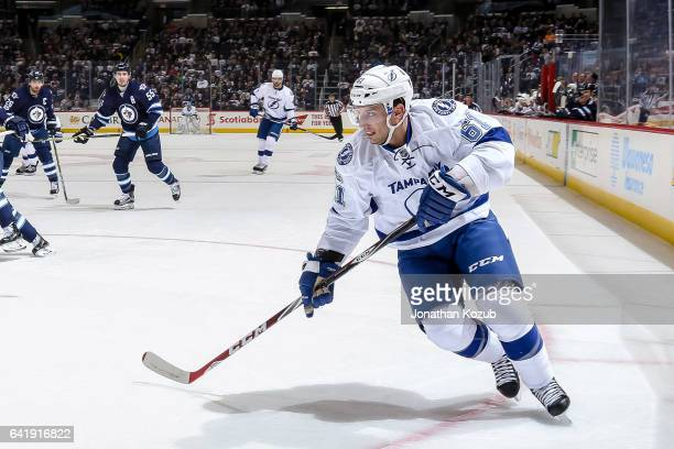 Gabriel Dumont of the Tampa Bay Lightning follows the play down the ice during first period action against the Winnipeg Jets at the MTS Centre on...